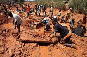 Muddied prospectors pan for gold in Manica Province, near the Zimbabwe border, September 17, 2010. Hundreds of miners work in individual claims rented from local landowners.   REUTERS/Goran Tomasevic  (MOZAMBIQUE - Tags: SOCIETY EMPLOYMENT BUSINESS)